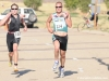 Adam Coy (left) and Donavon Guyot (right) race to the finish line