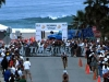 Swimmers leave the surf and bike out of T1