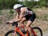 Tim Hola hammers the bike