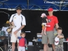 Tim Hola (left) and Kirk Framke (right) collect their awards with help from their kids
