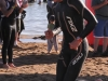 Simon Thompson exits the water a half minute behind Van Akkeren