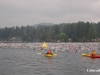 Swimmers escorted by kayaks in Lake Placid
