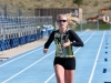 Courtney Clark, a 19-year-old CU sophomore, finishes the run to help lead her team, Buff Em Up, to the coed relay title.