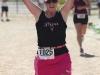 Kristen Howorko celebrates her finish