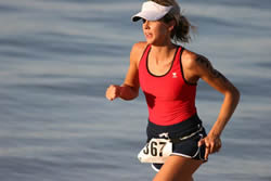 Monica Beck, who finished 38th in the women's race, runs along the beach