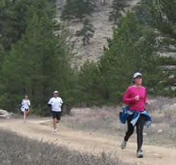 Erin Crisson leads Dwayne Windisch and Elizabeth West down a trail in Rocky Mountain National Park