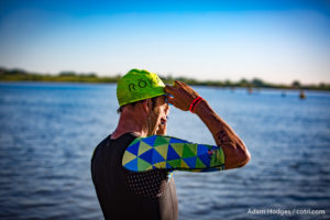 Boulder, CO -- June 11, 2016: Rafael Goncalves of Brazil prepares for the swim start of the Ironman 70.3 Boulder. He went on to clock the fastest swim of the day with a time of 24 minutes 8 seconds for the 1.2-mile course.