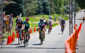 Niwot, CO, USA - June 26, 2016: Triathlete Flora Duffy (middle) takes the win while fellow triathlete Paula Findlay (right) squeaks out a close second in the Senior Women Pro/Category-1/Category-2 competition at the Niwot Circuit Race.