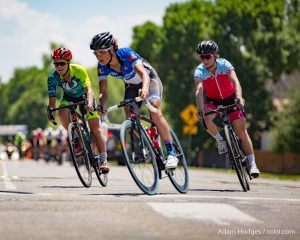 Niwot, CO, USA - June 26, 2016: The Senior Women Pro/Category-1/Category-2 field rounds a corner during the Niwot Circuit Race.